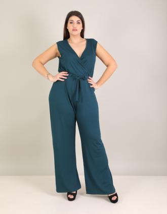 Κρουαζέ ολόσωμη φόρμα για μεγάλα μεγέθη με ζώνη σε ελαστικό ζέρσεϊ.Το  μοντέλο φοράει  784e57b6ca3